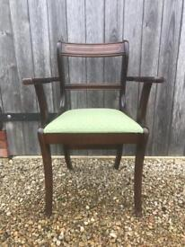 10 matching dark mahogany coloured dining chairs with matching green fabric seat pads