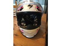 Woman's motorbike helmet.
