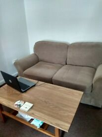 2 seat sofa 1 coffee table and 1 Vax vacuum cleaner