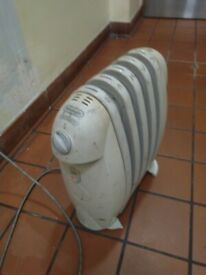 Small DeLonghi oil-filled electric radiator central London bargain