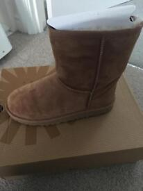 Tan kids uggs