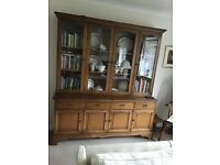 cupboard with glass fronted bookcase on top
