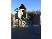 Childs Wooden treehouse with slide for outdoors.