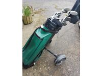 Full set of Memphis golf clubs plus bag, trolley and dozen balls. All good cond.