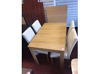 Table and 4 Cream Skirted Chairs