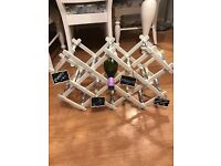 Shabby chic wine rack painted in Antique white chalk paint and decoupaged. Wine included!