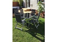 Large black glass garden table with 6 reclining chairs £100