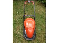 Almost new Flymo Easy Glide Lawnmower. Used once only. No longer required.