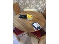 Beautiful solid oak dining room table and chairs