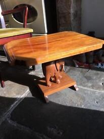 Two solid wooden elephant coffee/occasional tables