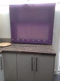 Purple roller blind for sale.