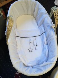 Moses basket with stand for sale.