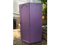 Small, narrow, purple cupboard