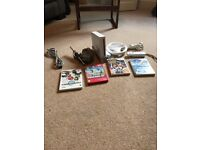 Nintendo Wii console , two hand controllers Mario Kart steering wheel and games.