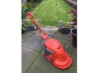 Flymo mow n vac lawn mower