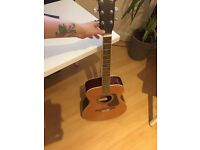 Like-new Vintage v300 acoustic guitar with learning stickers