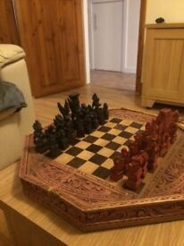 Hand carved wooden chess set with backgammon board