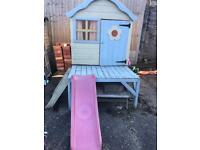 Children's wooden playhouse and slide and picnic bench