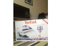 1 tefal iron new boxed perfect working order. can deliever