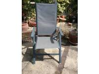 Two reclining patio chairs