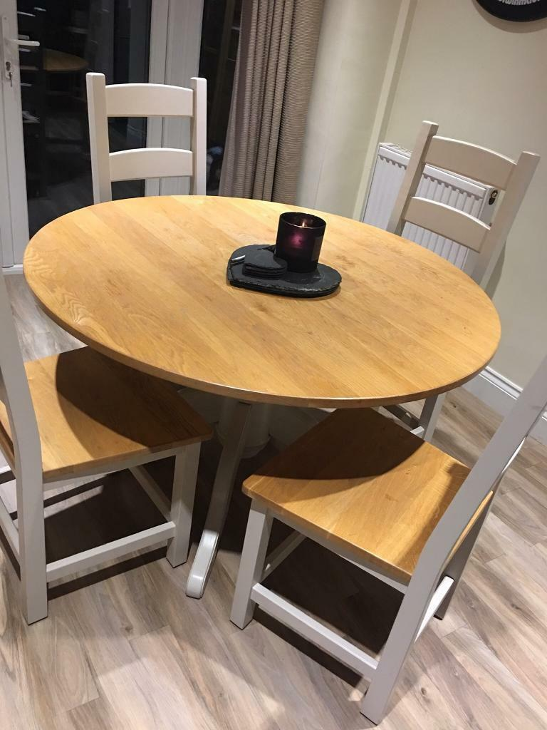 Round Dining Table And Four Chairs In Princes Risborough