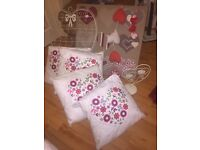 collection of cream and red heart cushions etc