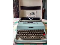 OLIVETTI LETTERA 32 TYPEWRITER WITH CARRY CASE AND INSTRUCTIONS