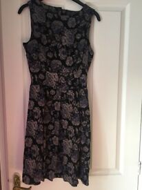 Closet London dress, size 12, unworn with tags. Slight open back. Thick material