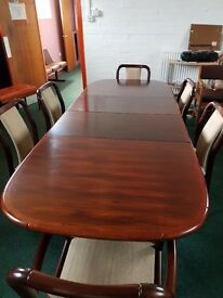 Solid dark oak extendable dining table with 6 chairs