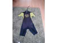 Rip curl shortie wet suit . size 16 . Lime green and black
