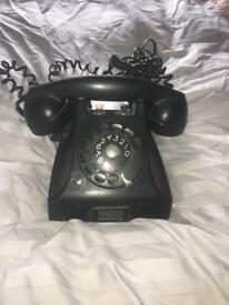 Black Bakelite telephone