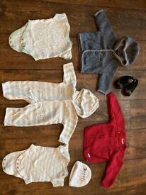 Bundle of newborn baby clothes