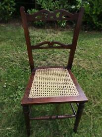 Pretty antique side/occasional chair with carved detail and woven cane seat
