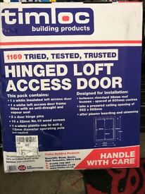 Hinged insulated loft access door