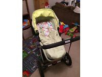 Mothercare My3 pram in green with accessories and optional buggy board.