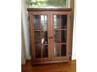 A glass fronted oak bookcase.