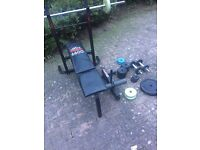Gym work out bench with a full range of weights