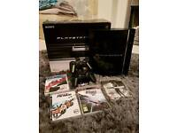 PS3 with 2 controllers & 4 games