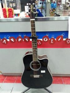 Jasmine Acoustic Guitar. We sell used Guitars. Get a Deal at Busters Pawn (#31244)
