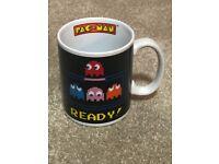 £1.. Retro PACMAN mug.