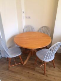 Pine dining table and 4 matching chairs