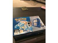 Nintendo 2ds console with Pokemon Sun and Omega Ruby