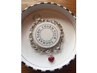 Thomas sabo sterling silver bracelet with red enamel charm.
