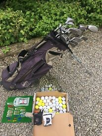 Full set of golf equipment, including bag, clubs, tees and ball etc