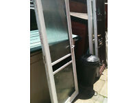 Exterior alloy door with 2 frosted double glazed panels and frame