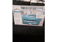 Spellbinders die cutting an embossing machine brand new. Plus rasberry embossing plate btrand new.