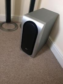 LG surround sound speakers and DVD player .