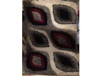Large modern rug red black