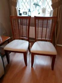 2 dining chairs cost 100£ each