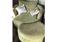 Three seater sofa and cuddle arm chair with foot stool